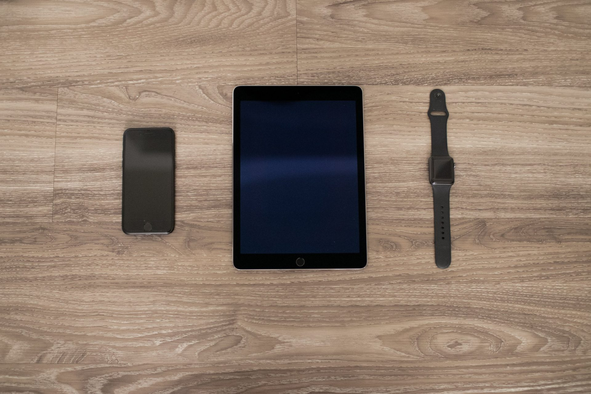 Apple Devices On Wooden Surface