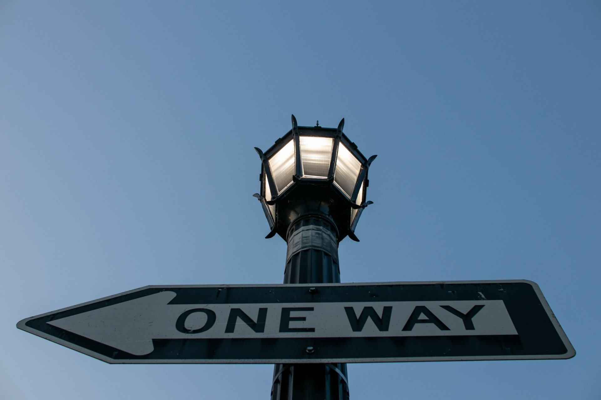 One Way Sign On Street Light Pole