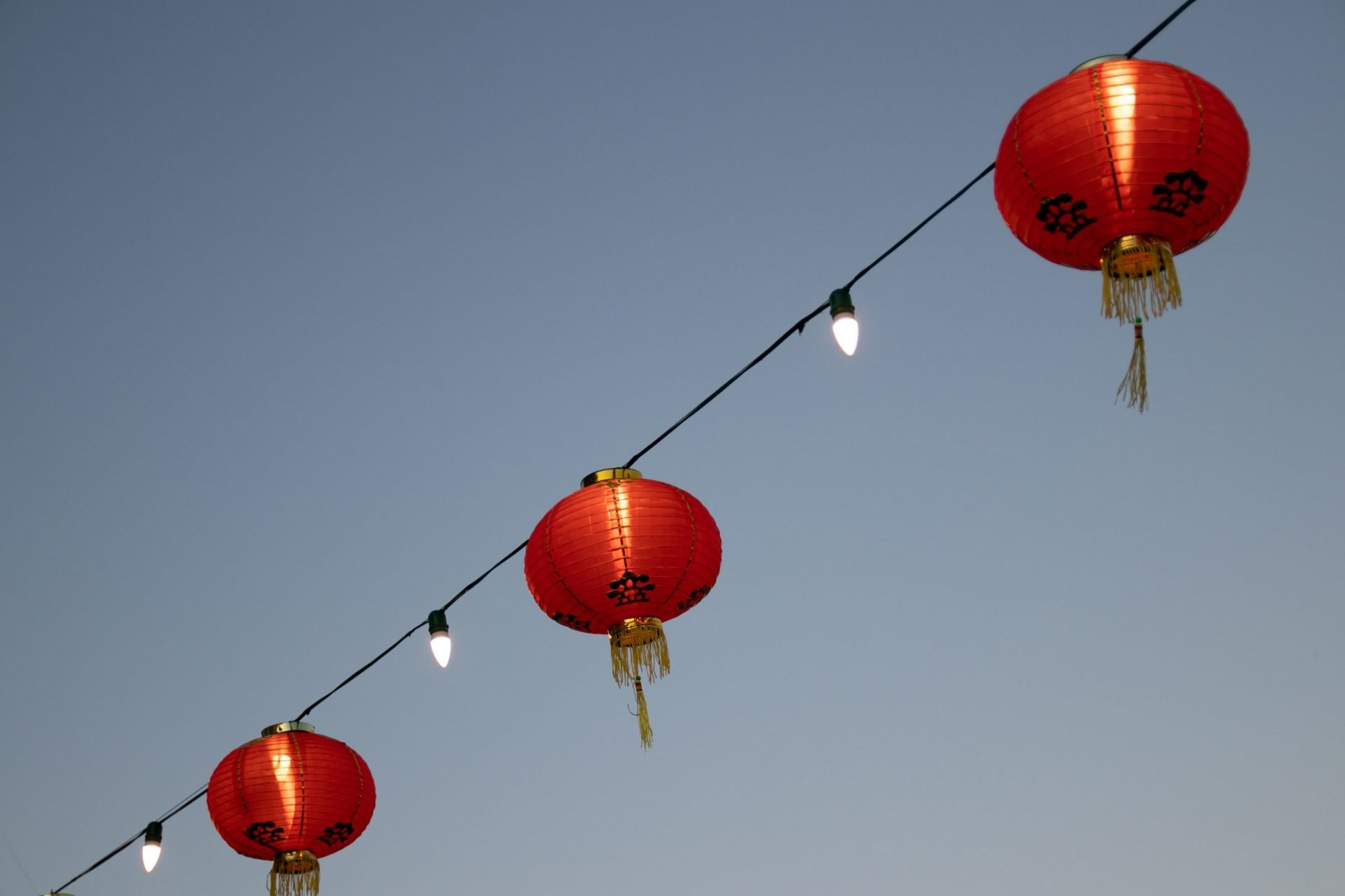 Round Chinese Paper Lanterns On String Lights