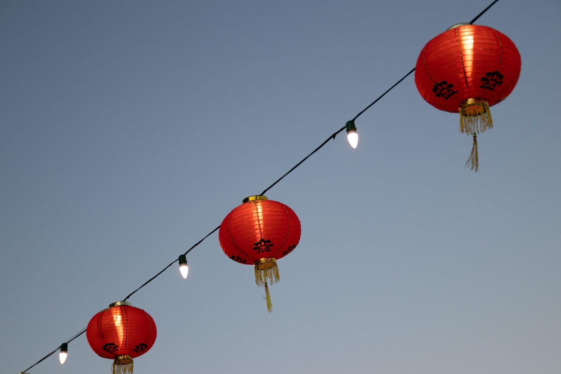 Round Chinese Paper Lanterns On String Lights