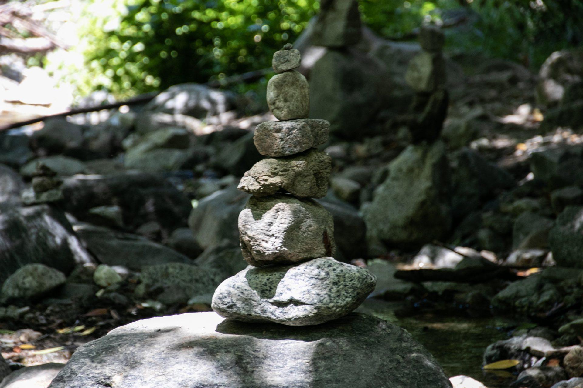 Stacked Rocks On Boulder In Nature