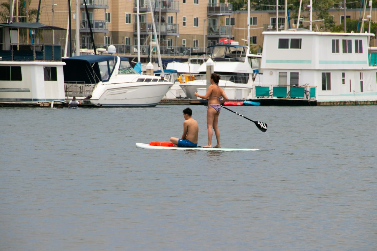 Two People On Surfboard On Water