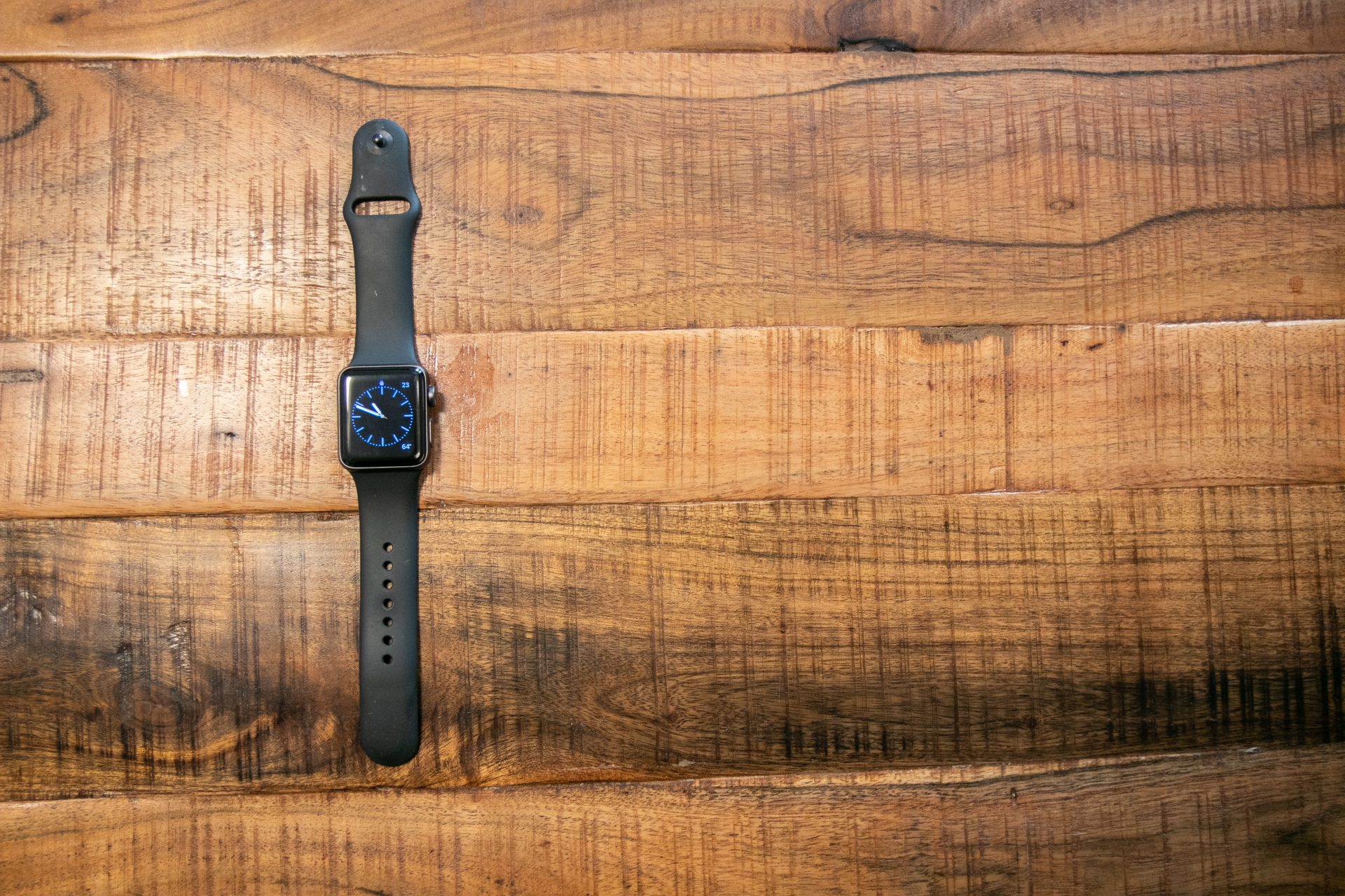 Black Smart Watch On Wooden Surface
