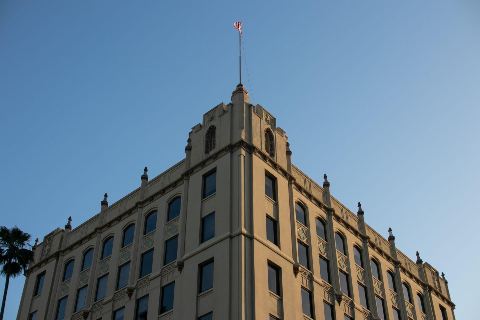 Flag On Corner Of Building