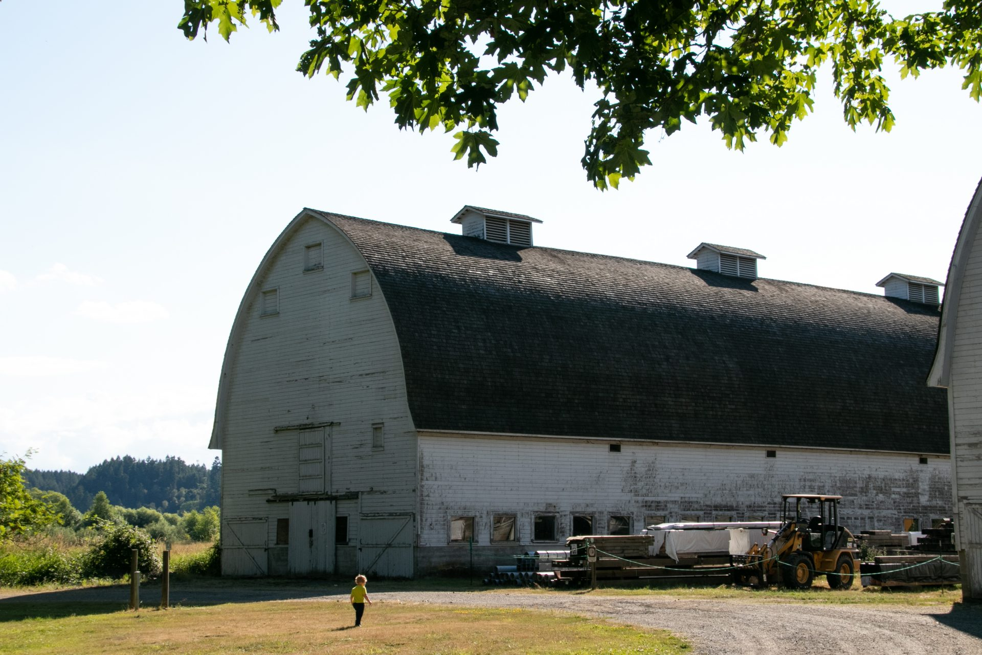 Heavy Equipments And Materials Near Gothic Barn