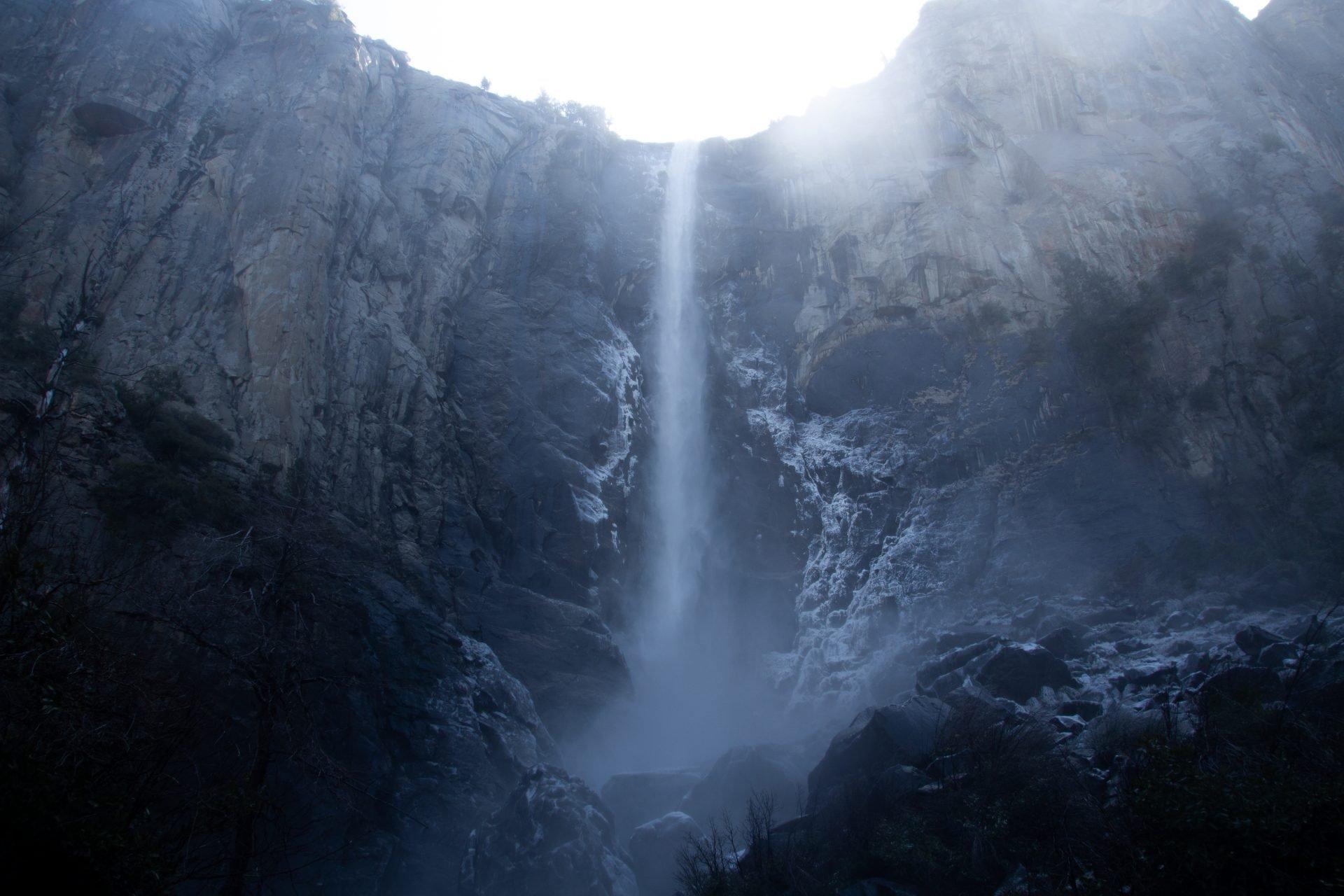 Long Waterfall Streaming Down Rock Cliff