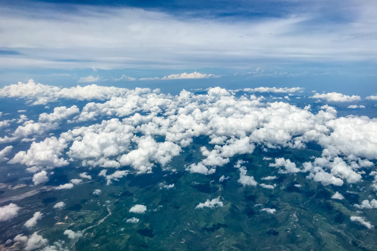 Small White Fluffy Clouds Above Mountains And Hills