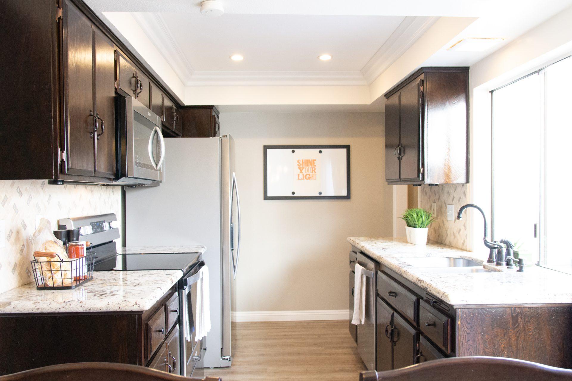 Sunlit Kitchen With Dark Cabinets