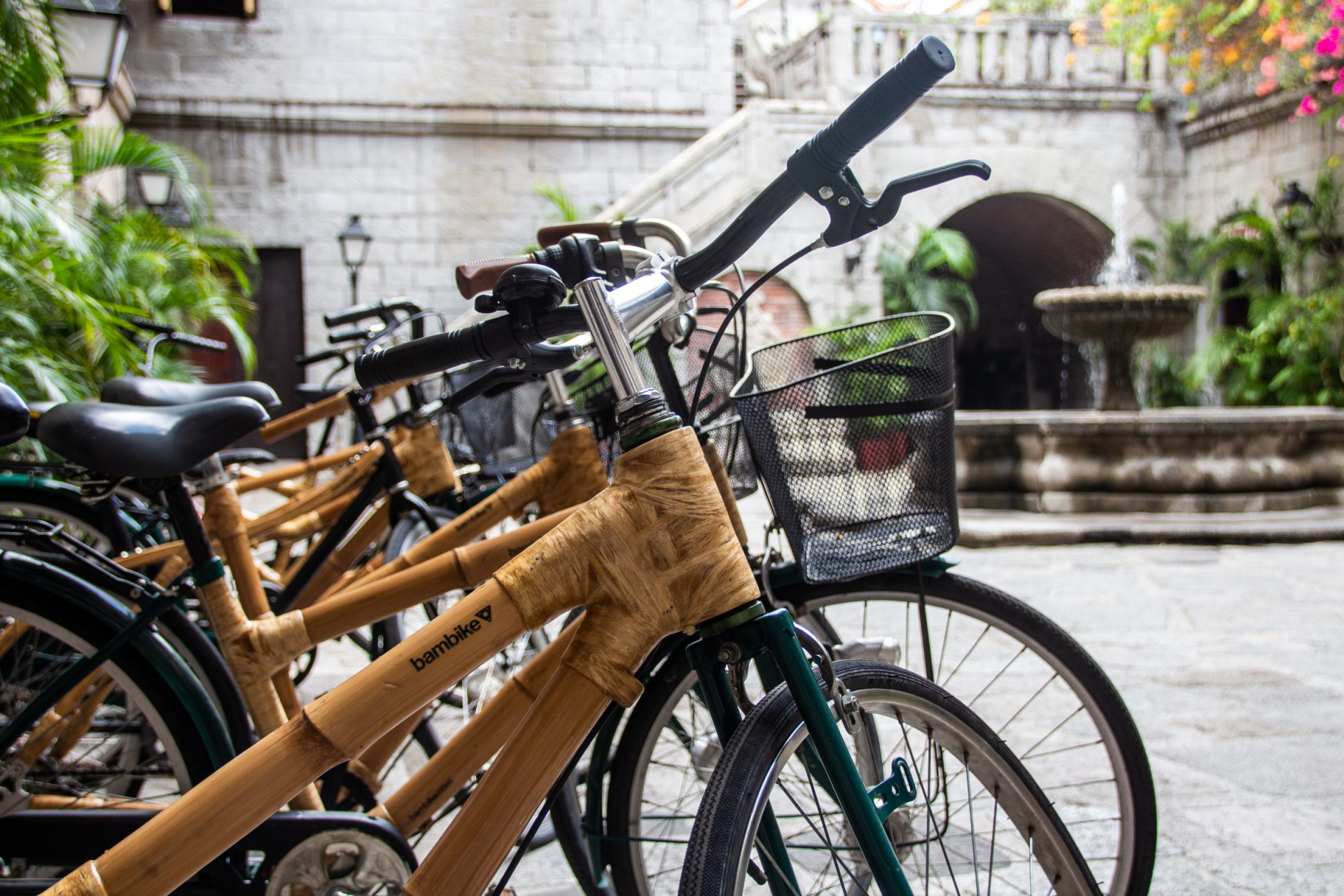 Bamboo Bicycles Parked Near Water Fountain