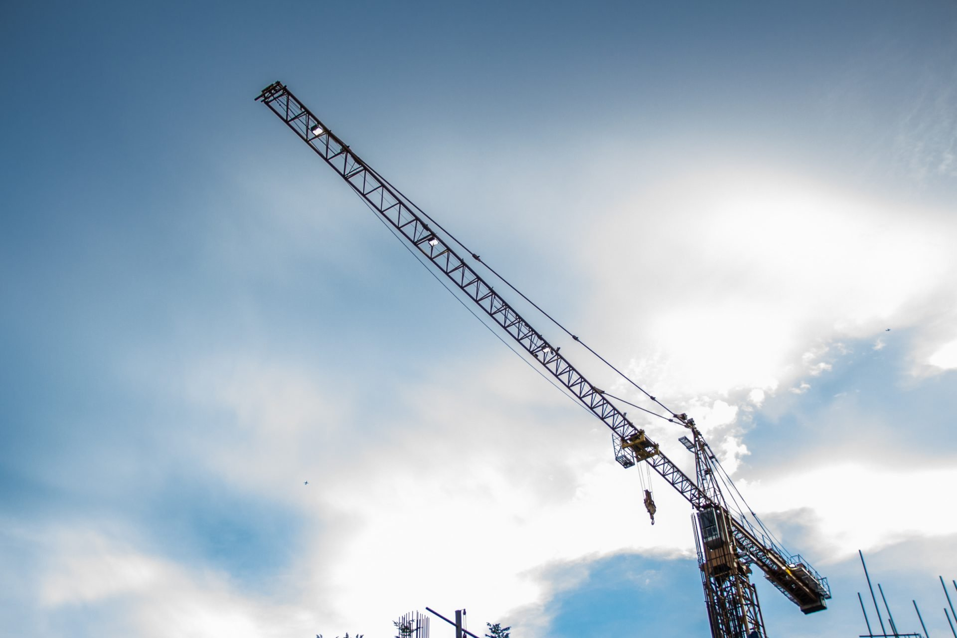 Crane Jib Against Clouds In Sky