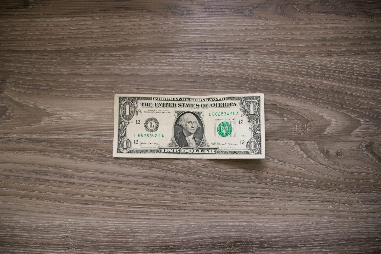 One US Dollar Bill On Wood