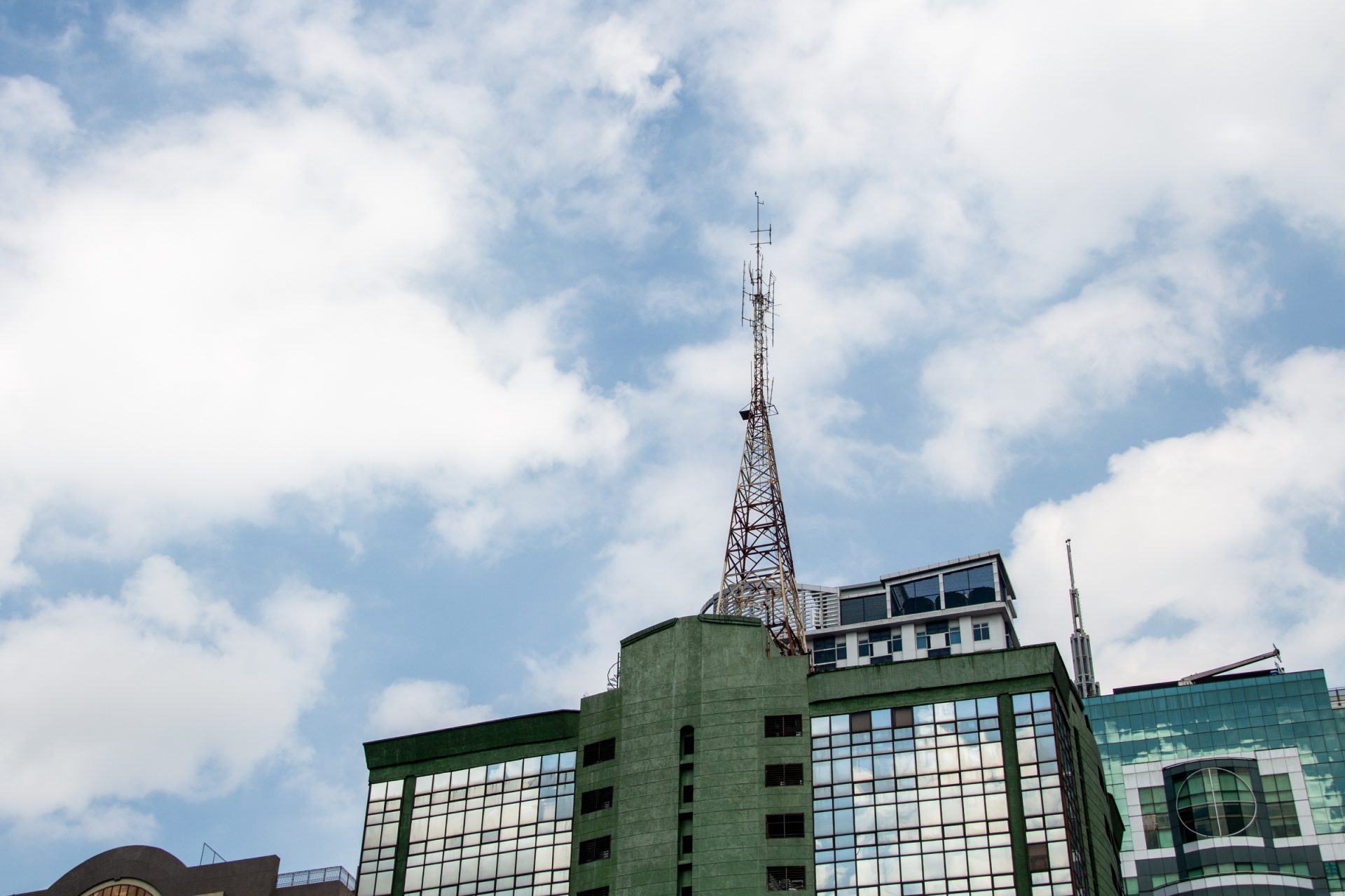 Radio Tower On Glass And Concrete Building