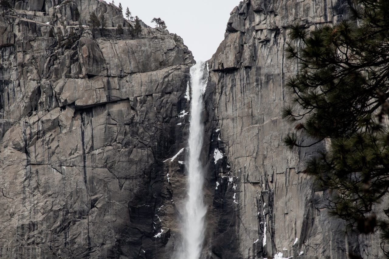 Waterfall On Jagged Rock Cliff