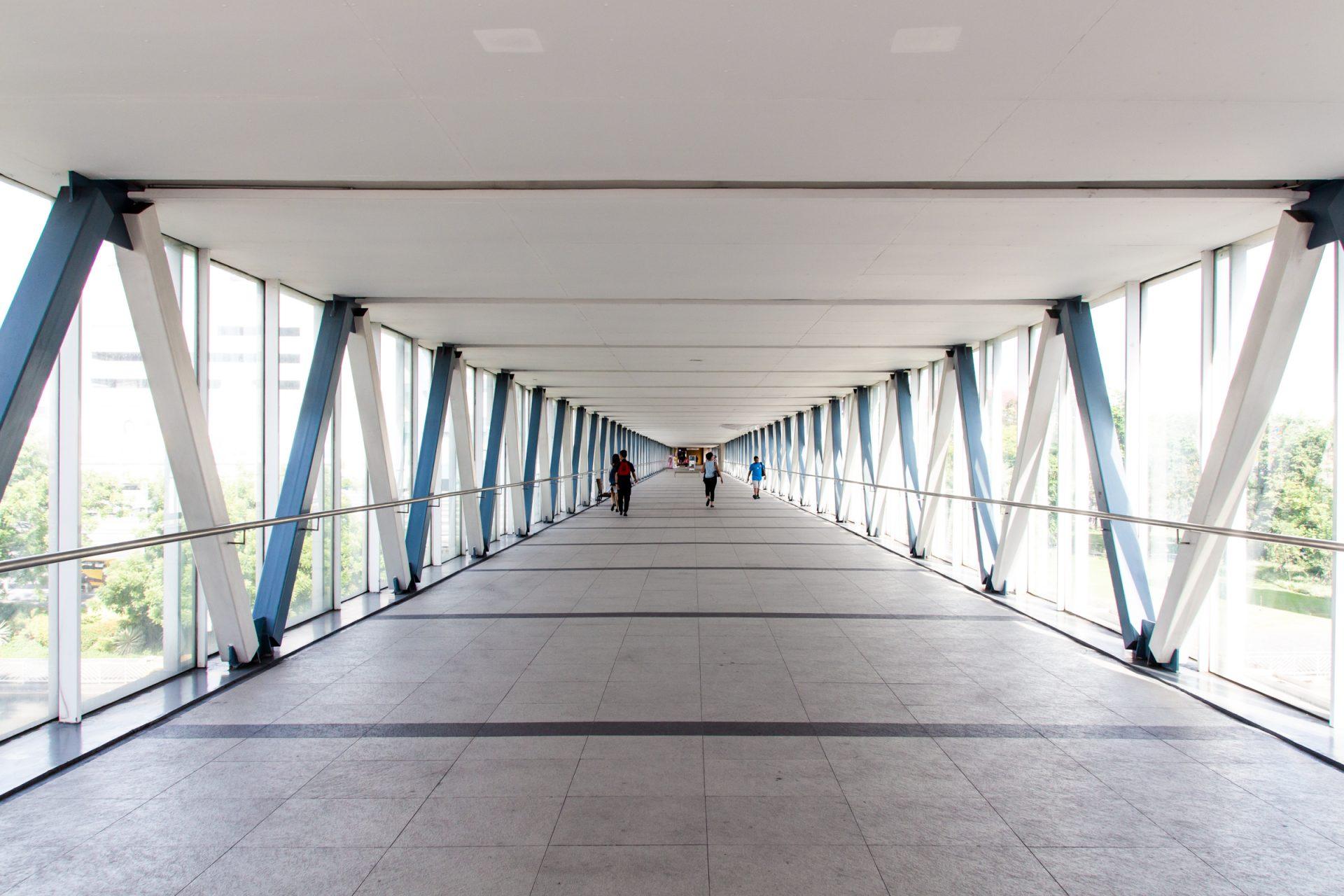 Few People Walking Inside Skybridge