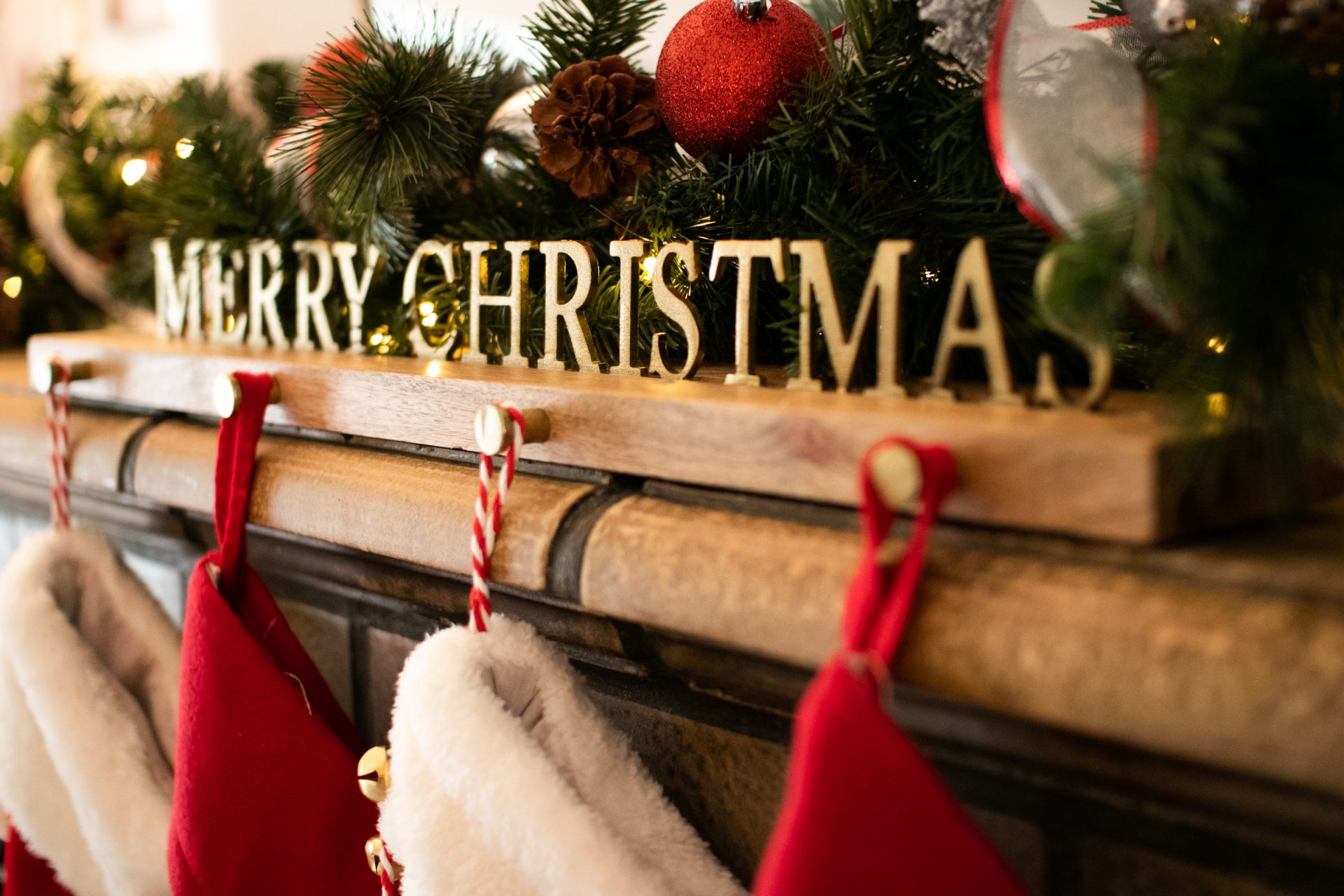 Christmas Decorations And Stocking Holder On Mantel