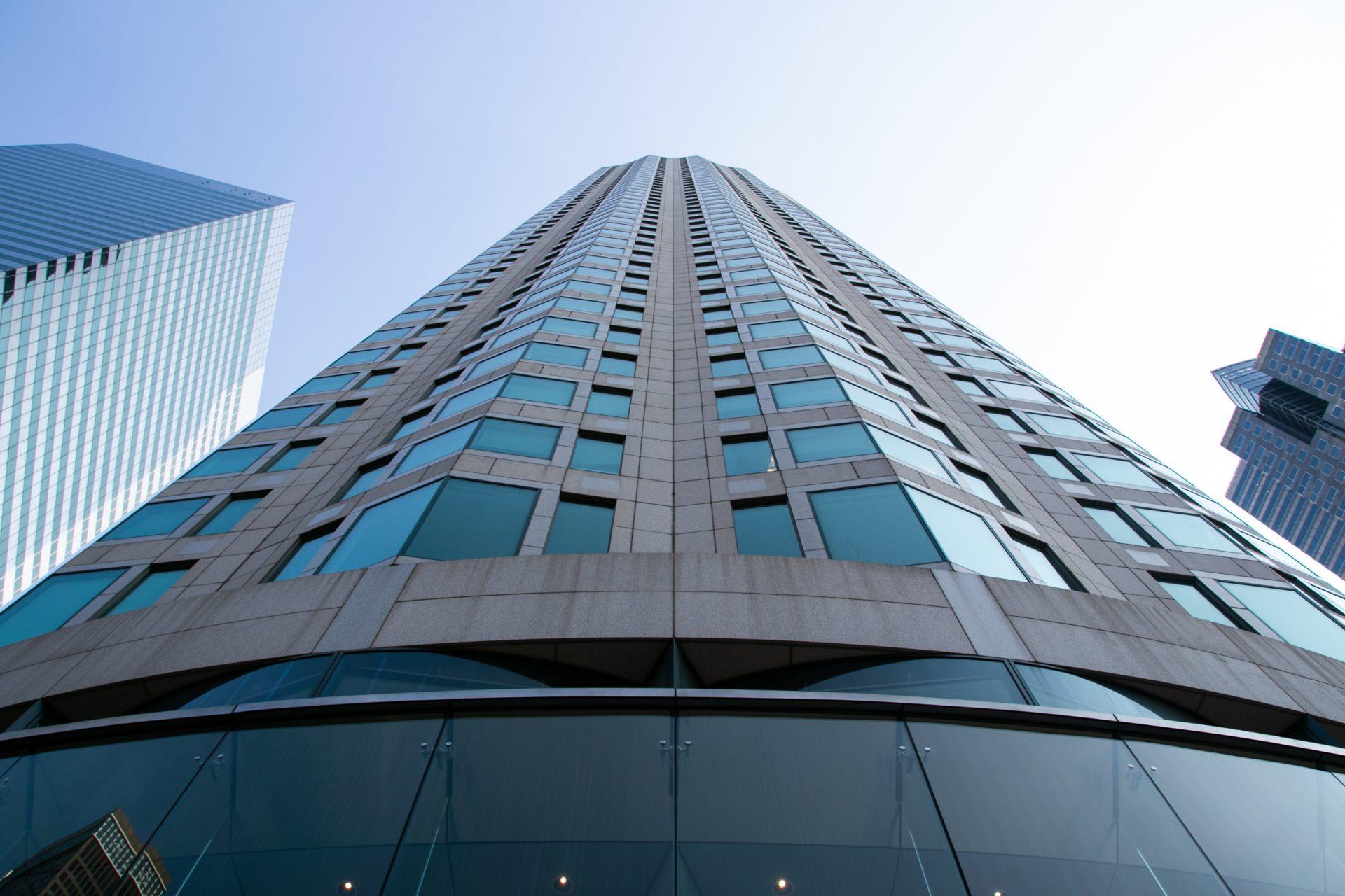 Facade Of Tall Building Against Sky