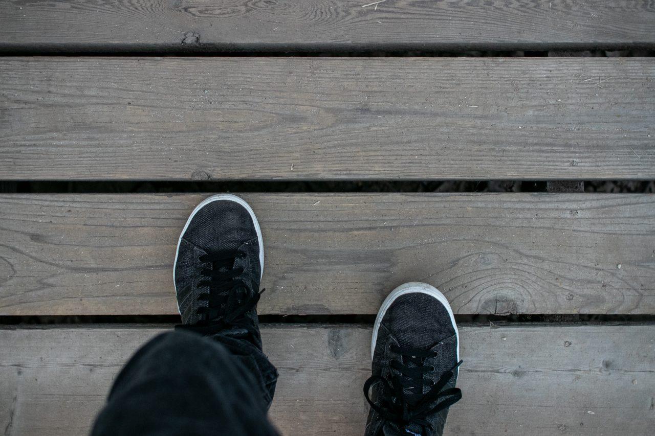 Feet Walking On Wood Boards