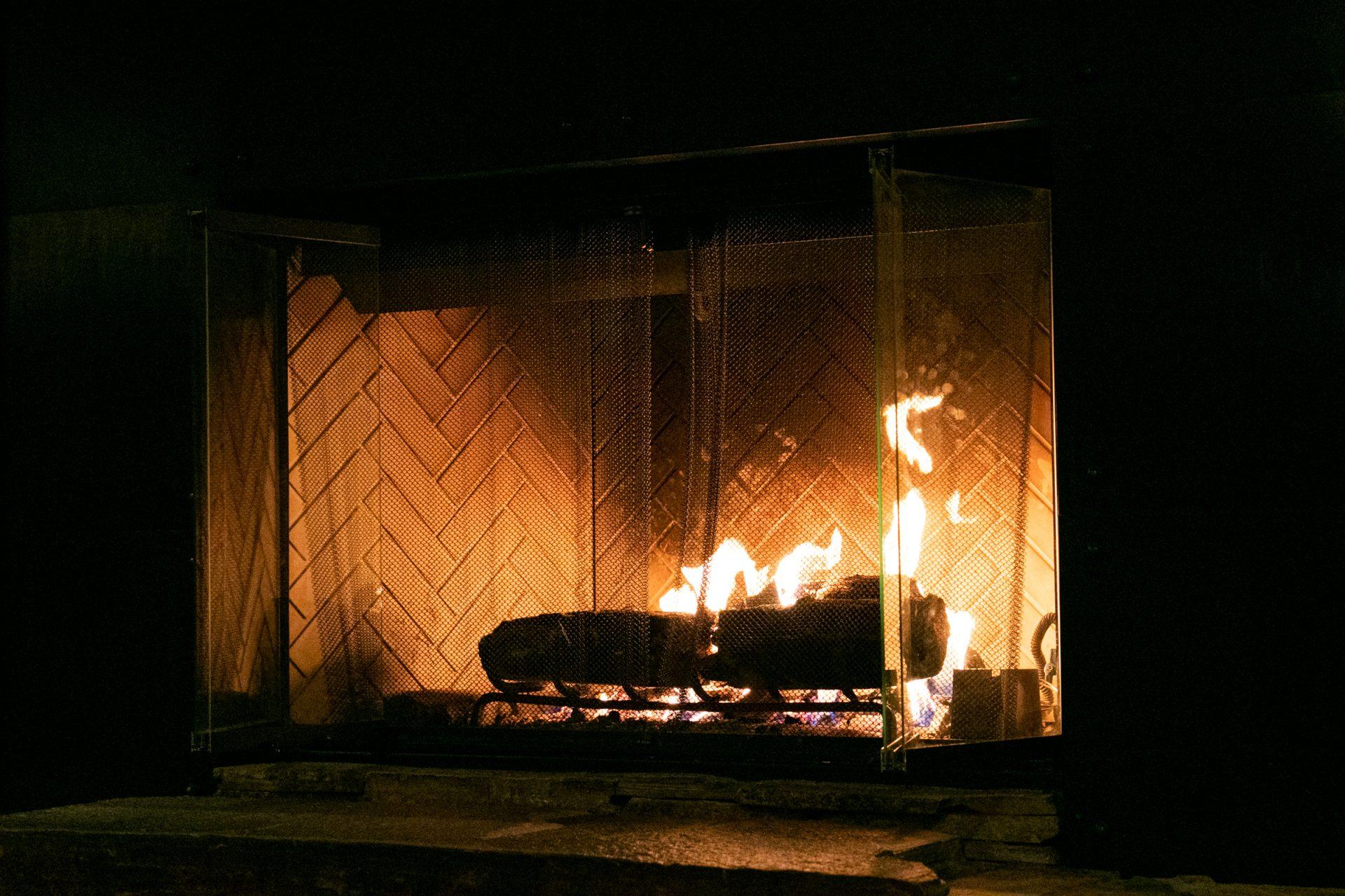 Flickering Wood Fire In Fireplace