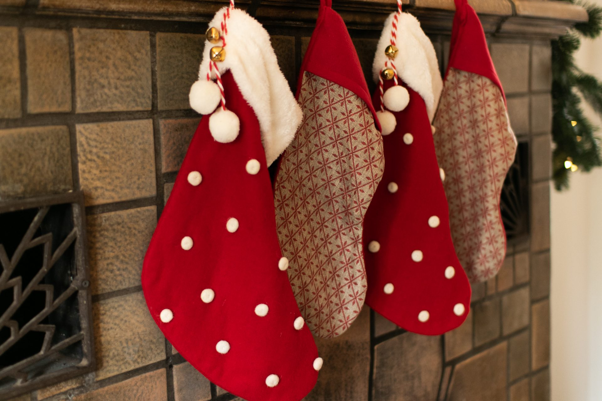 Four Stockings Hung On Mantel