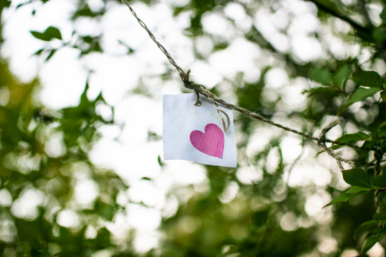 Heart Shape On Piece Of Paper Threaded To Twine