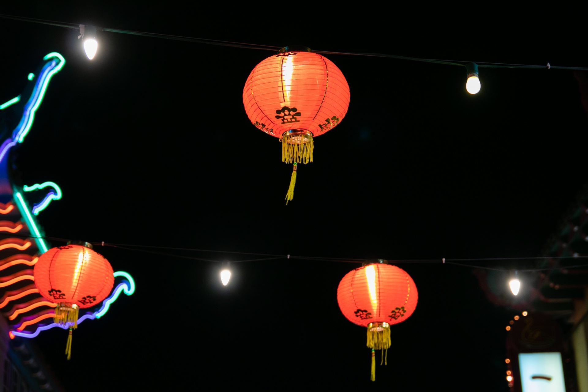 Illuminated Red Paper Lanterns Against Night Sky