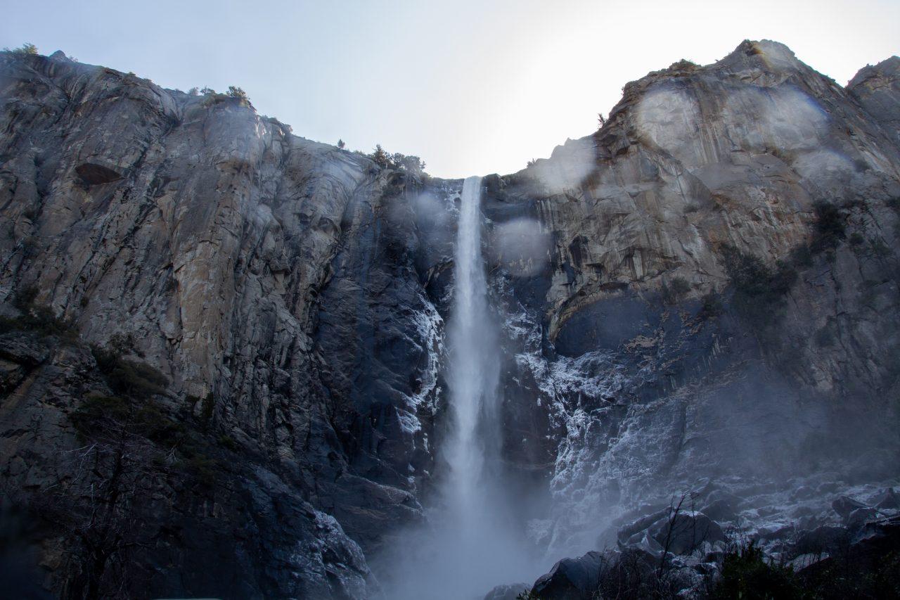 Narrow Waterfall On High Mountain Cliff
