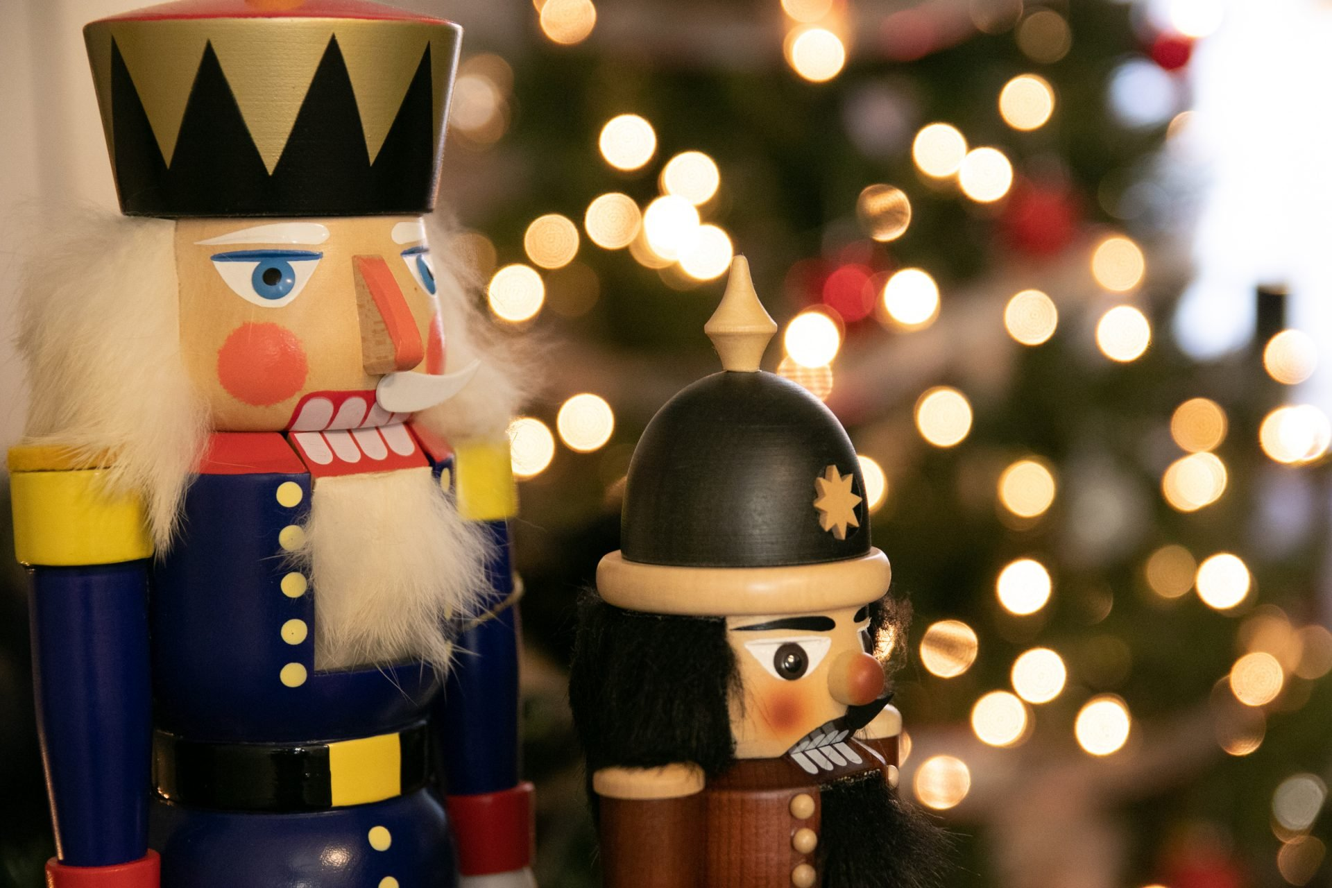 Nutcrackers Near Lit Christmas Tree