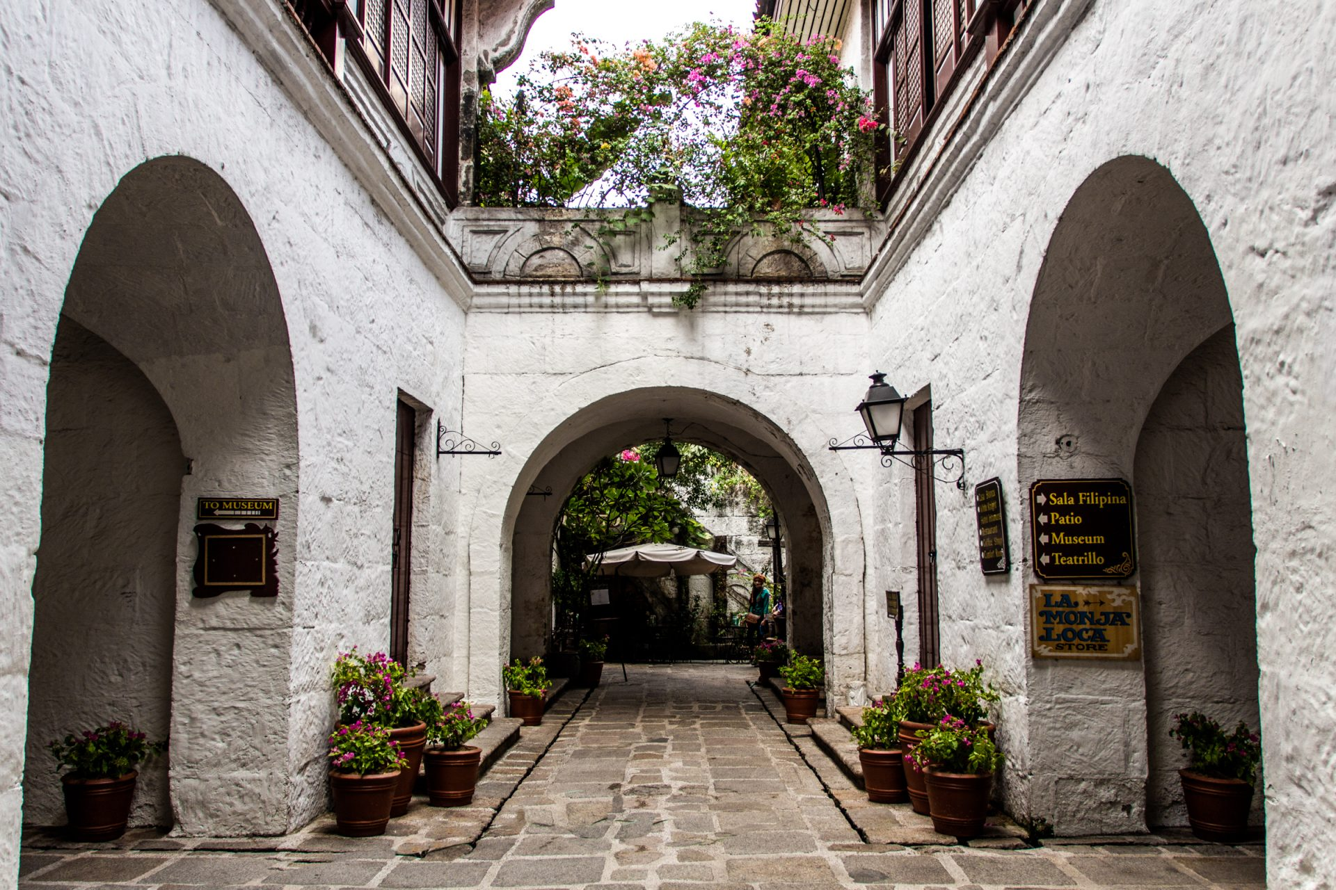 Passage With Potted Plants And Archways