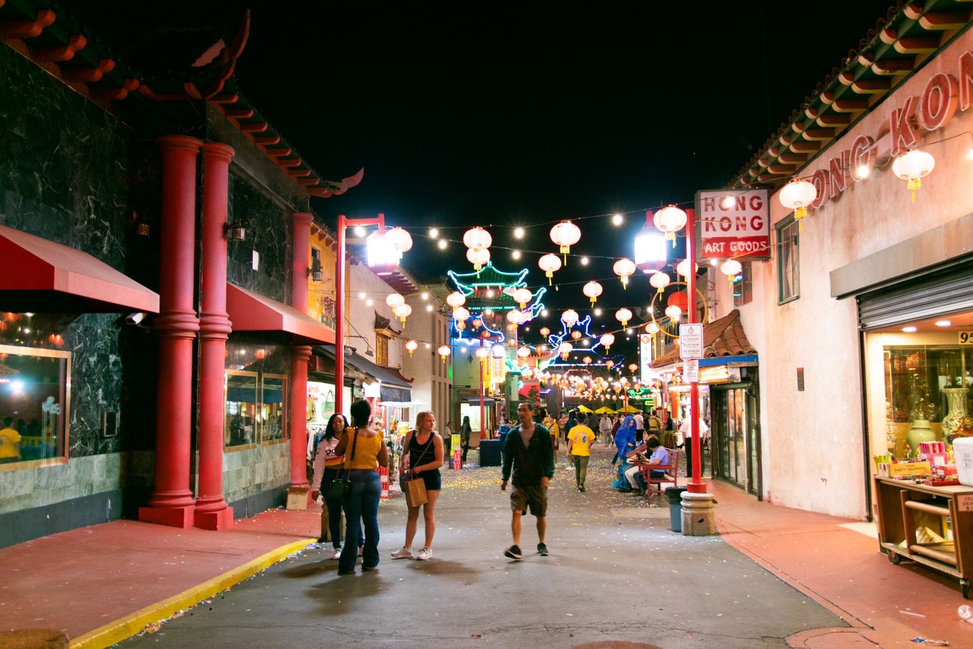 People In Brightly Lit Street In Chinatown At Night
