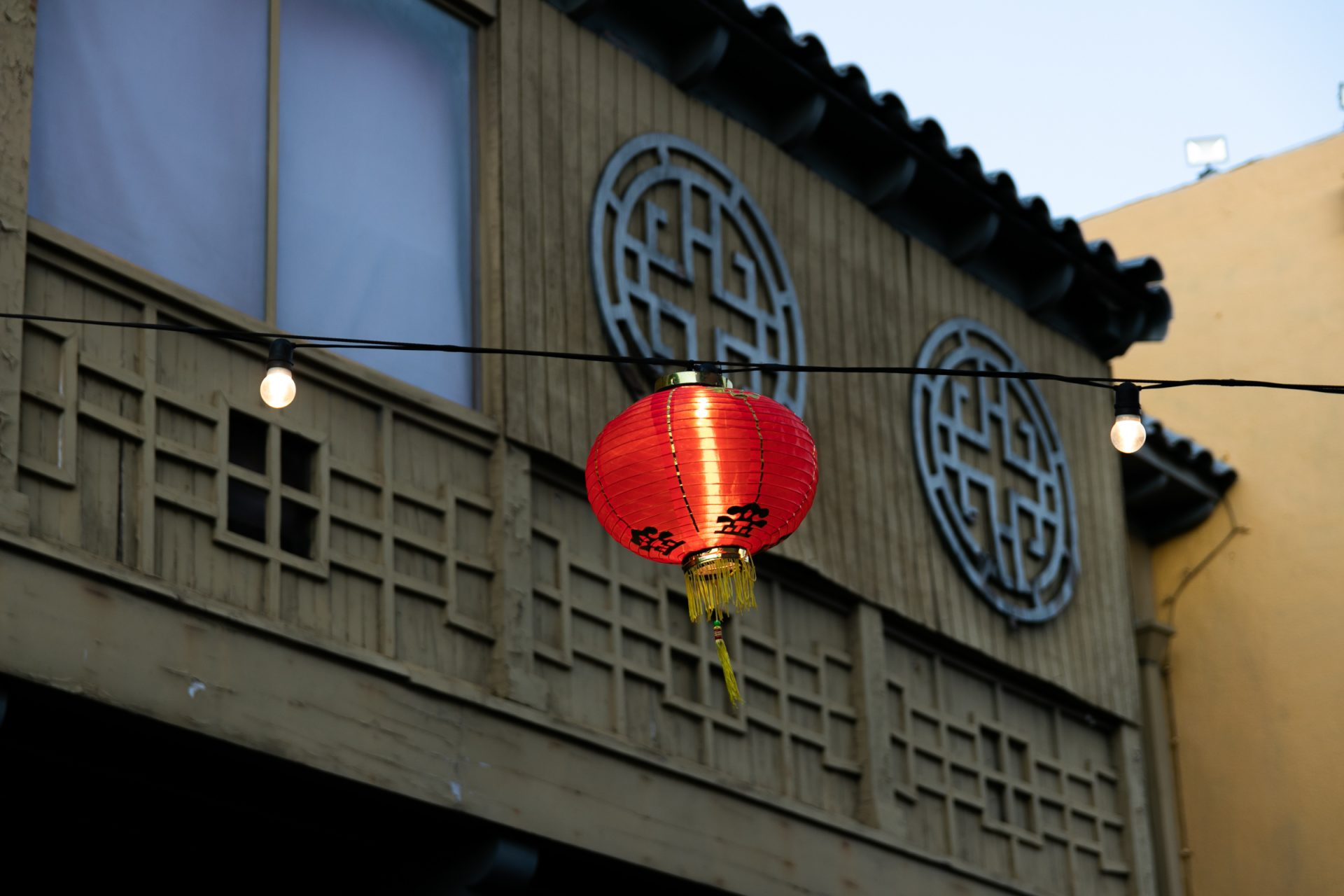 Red Paper Lantern On String Against Building