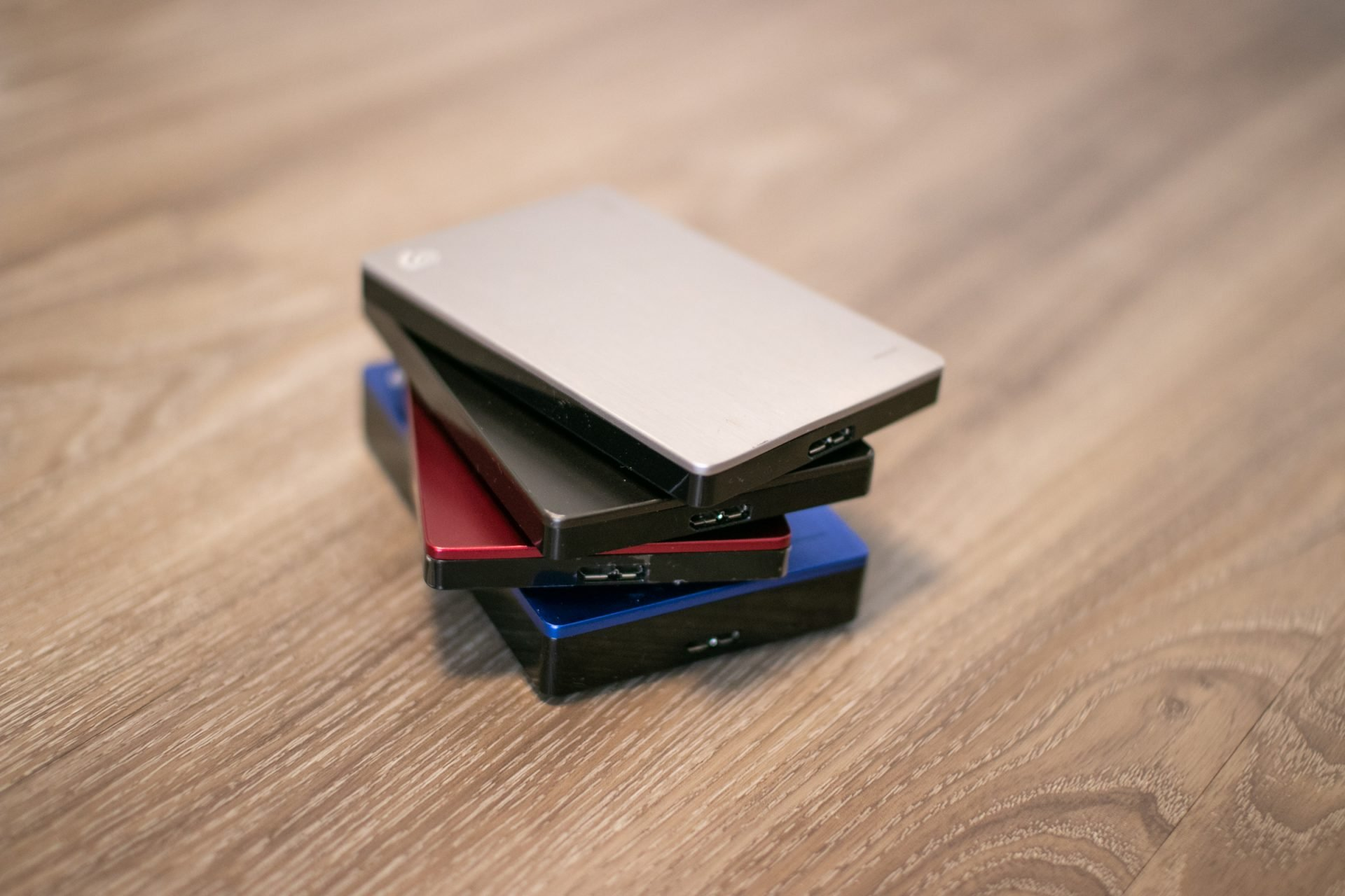 Stack Of Four Hard Disks On Wood
