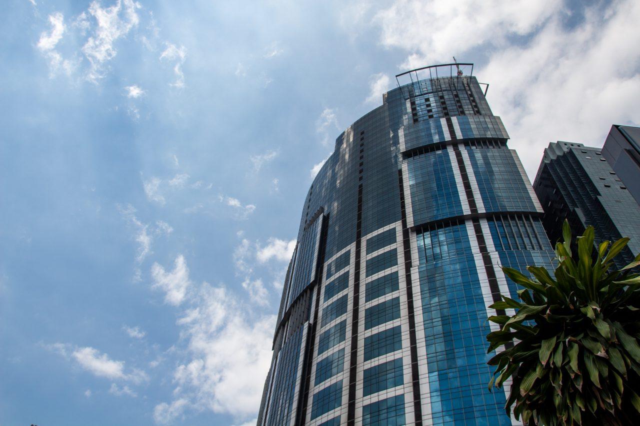 Tall Glass Building Against Sky