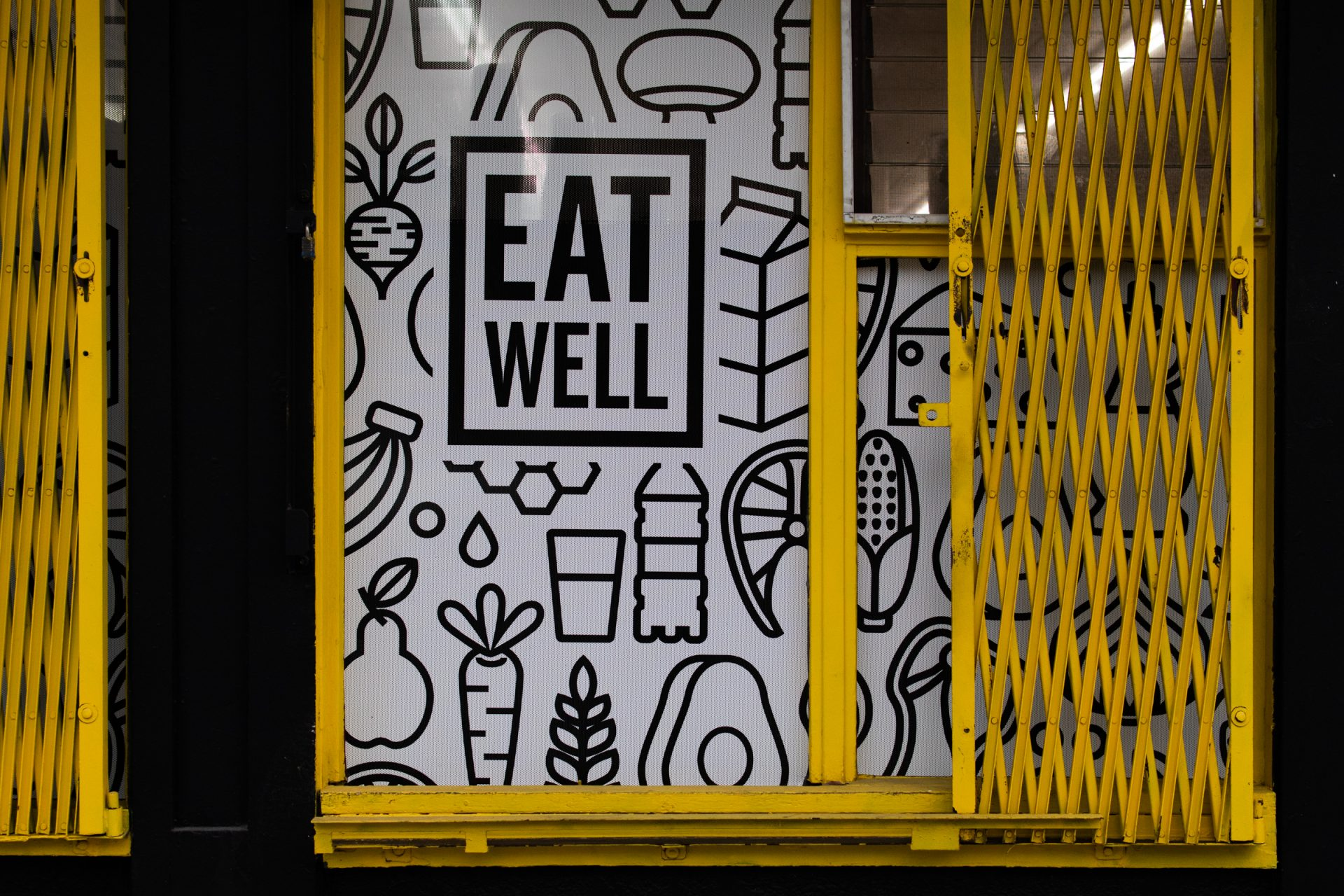 Eat Well Illustration On Storefront With Folding Doors