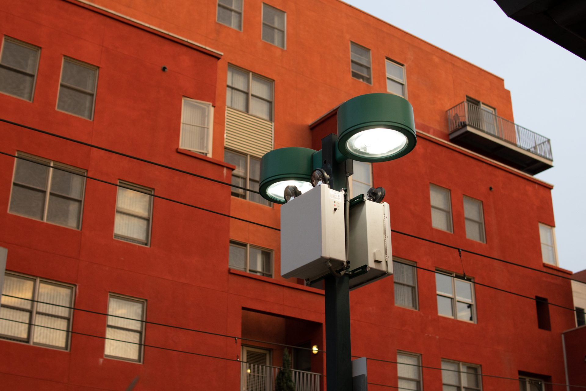 Streetlight In Front Of Red Orange Apartment Building