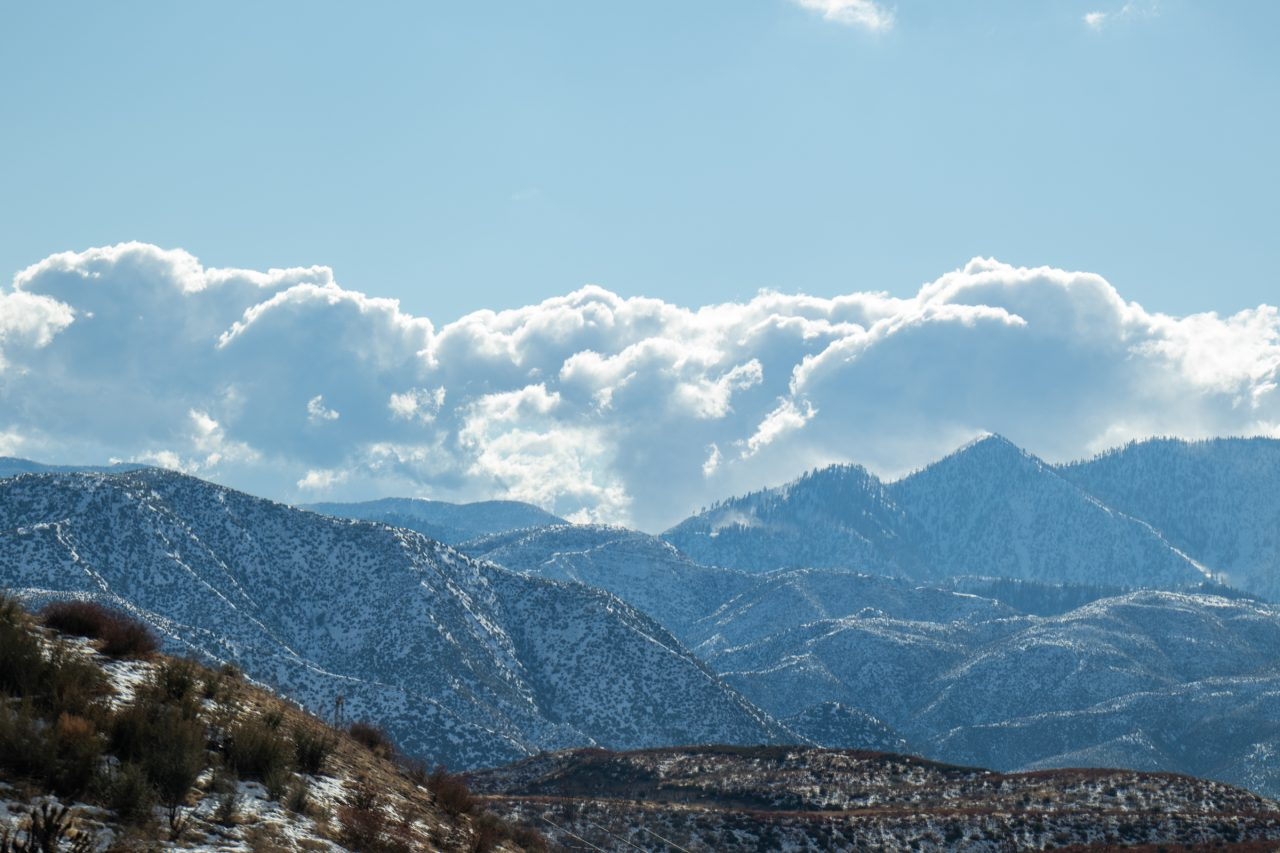 Big Puffy Clouds Above Mountains