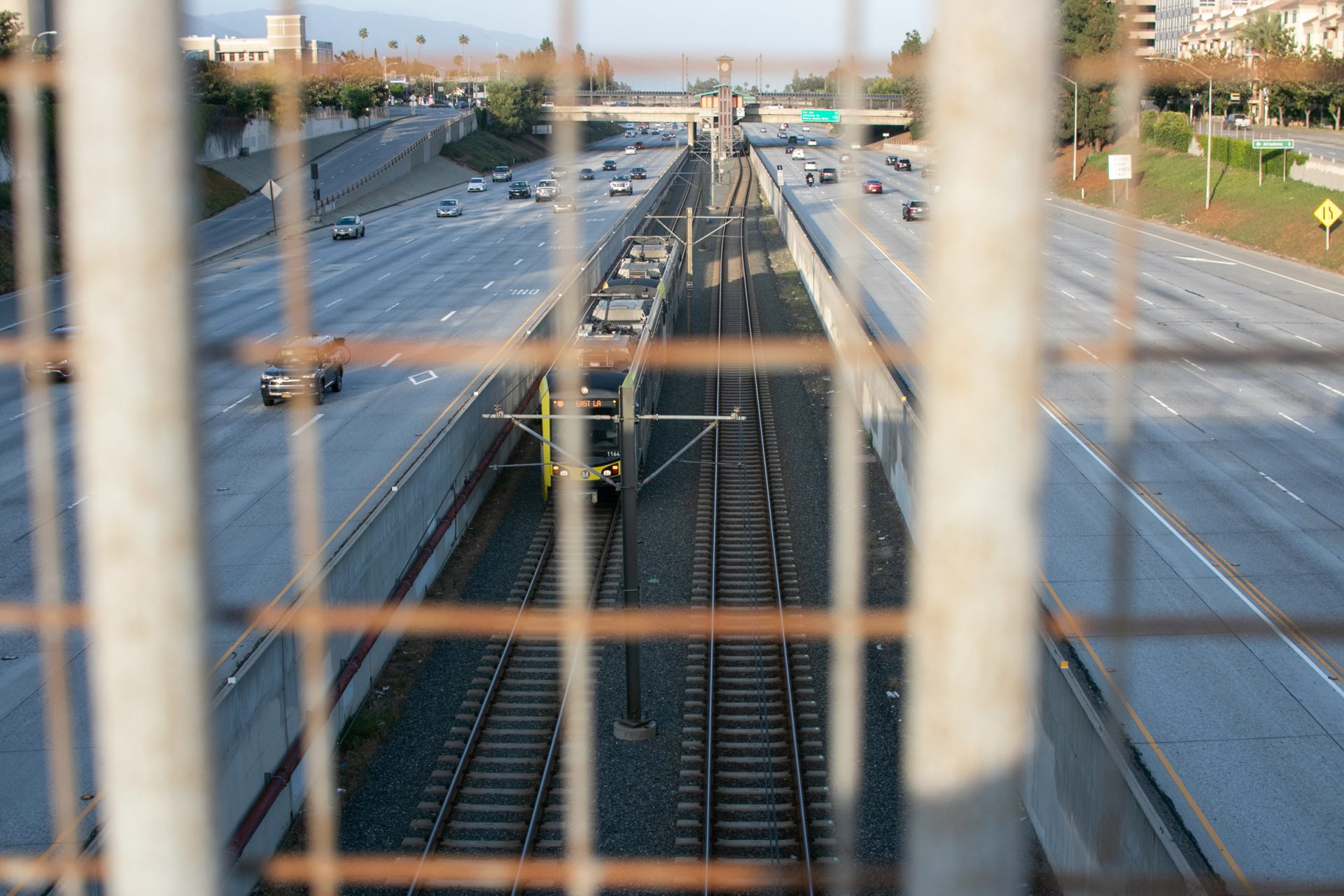 Train Between Traffic In Highway