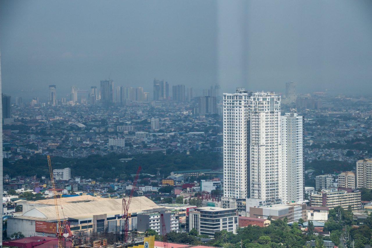 City Skyline Beyond Tall White Building