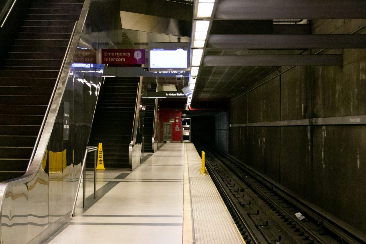 Empty Subway Platform With Escalators