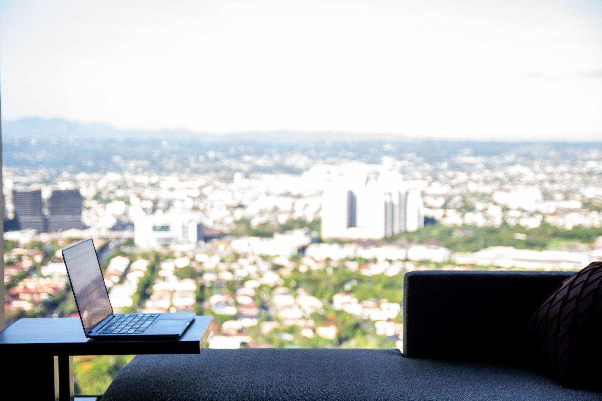 Laptop On Table Near Window With View