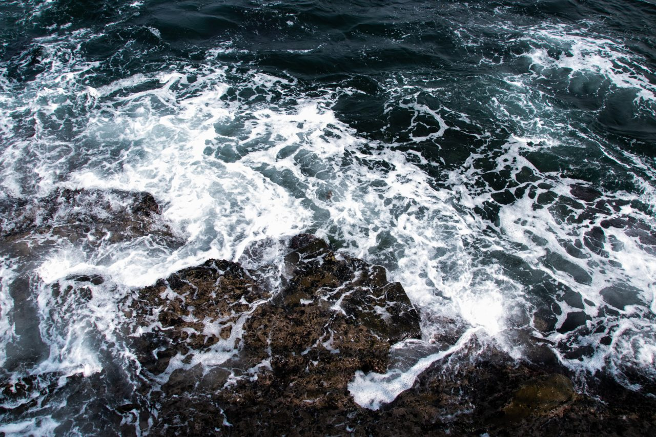 Sea Foam On Rocky Shore