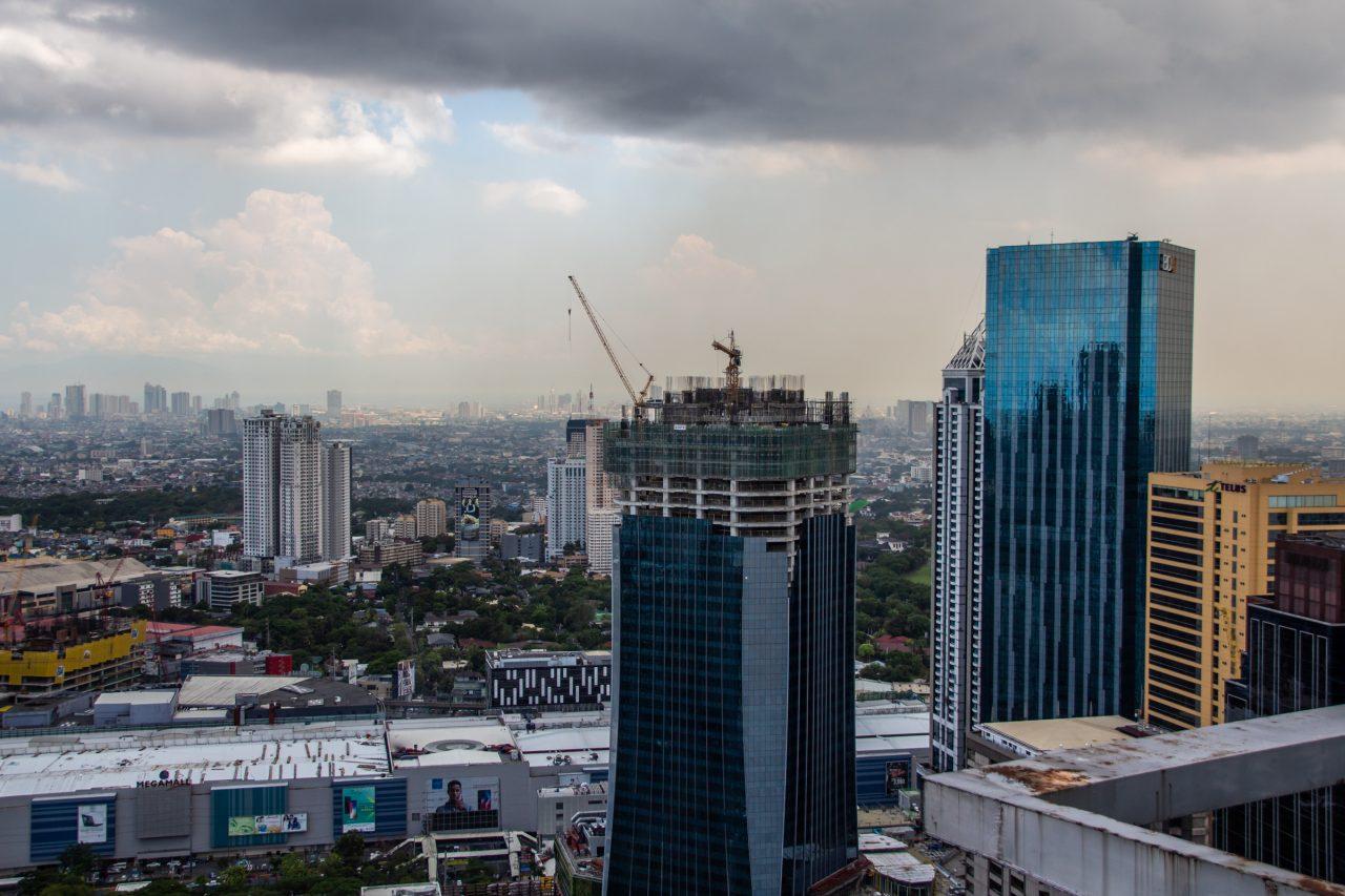 Tall Building Under Construction In Metropolitan Area