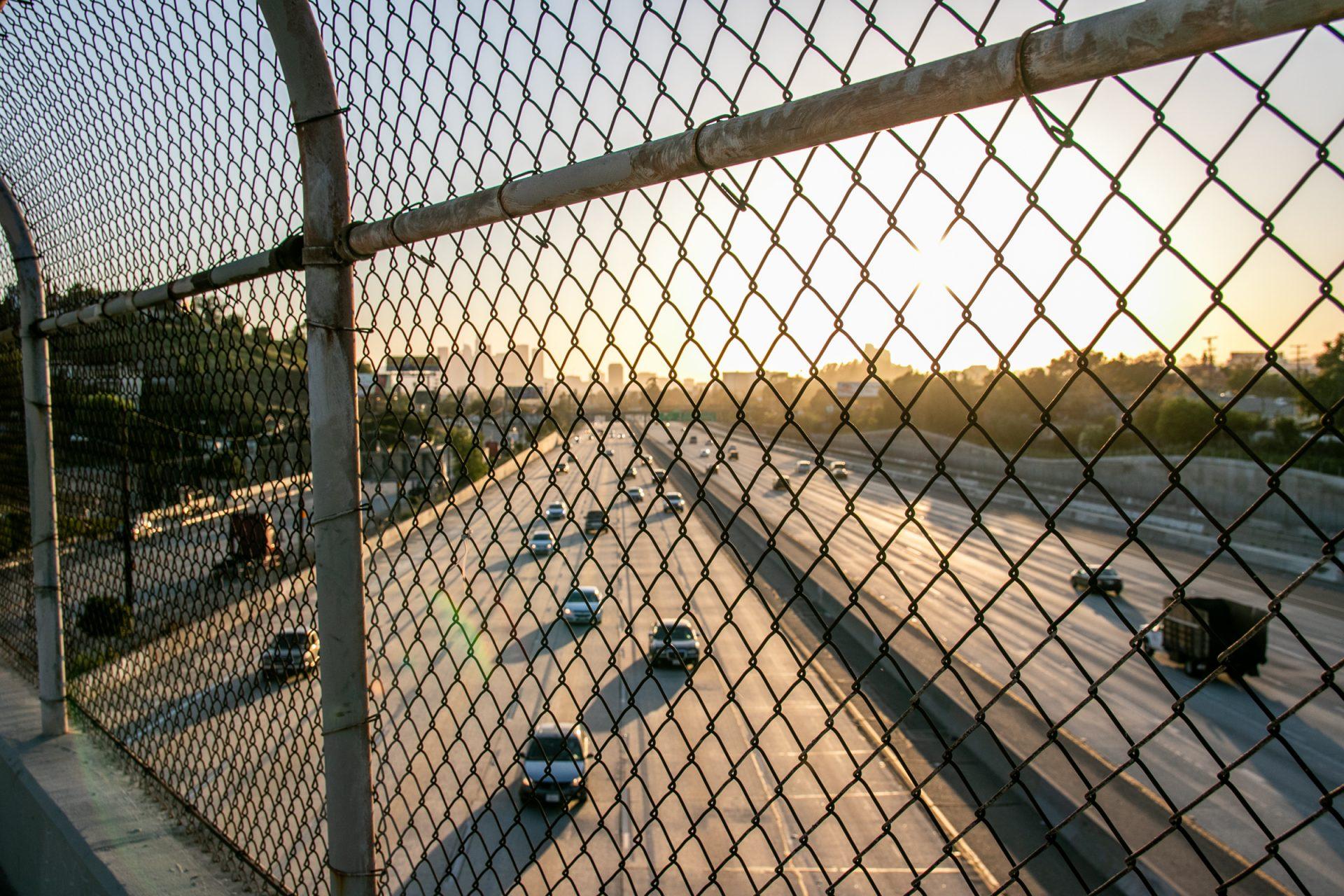 Traffic In Highway Through Bridge Wire Mesh