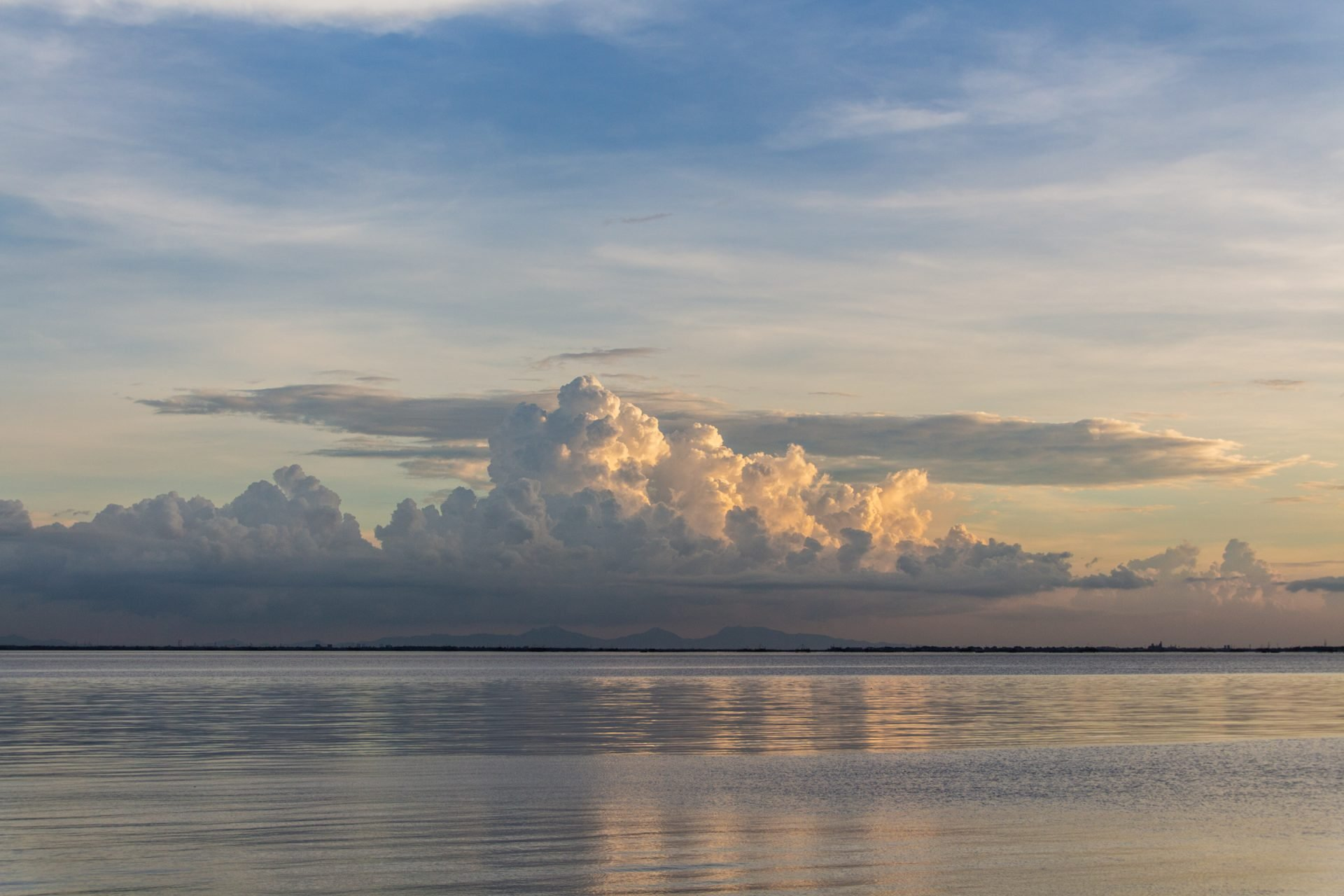 Big Clouds Above Large Body Of Water