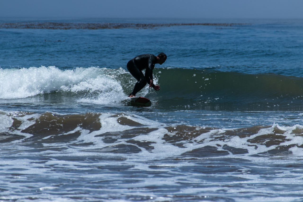 Man Riding Waves On Surfboard