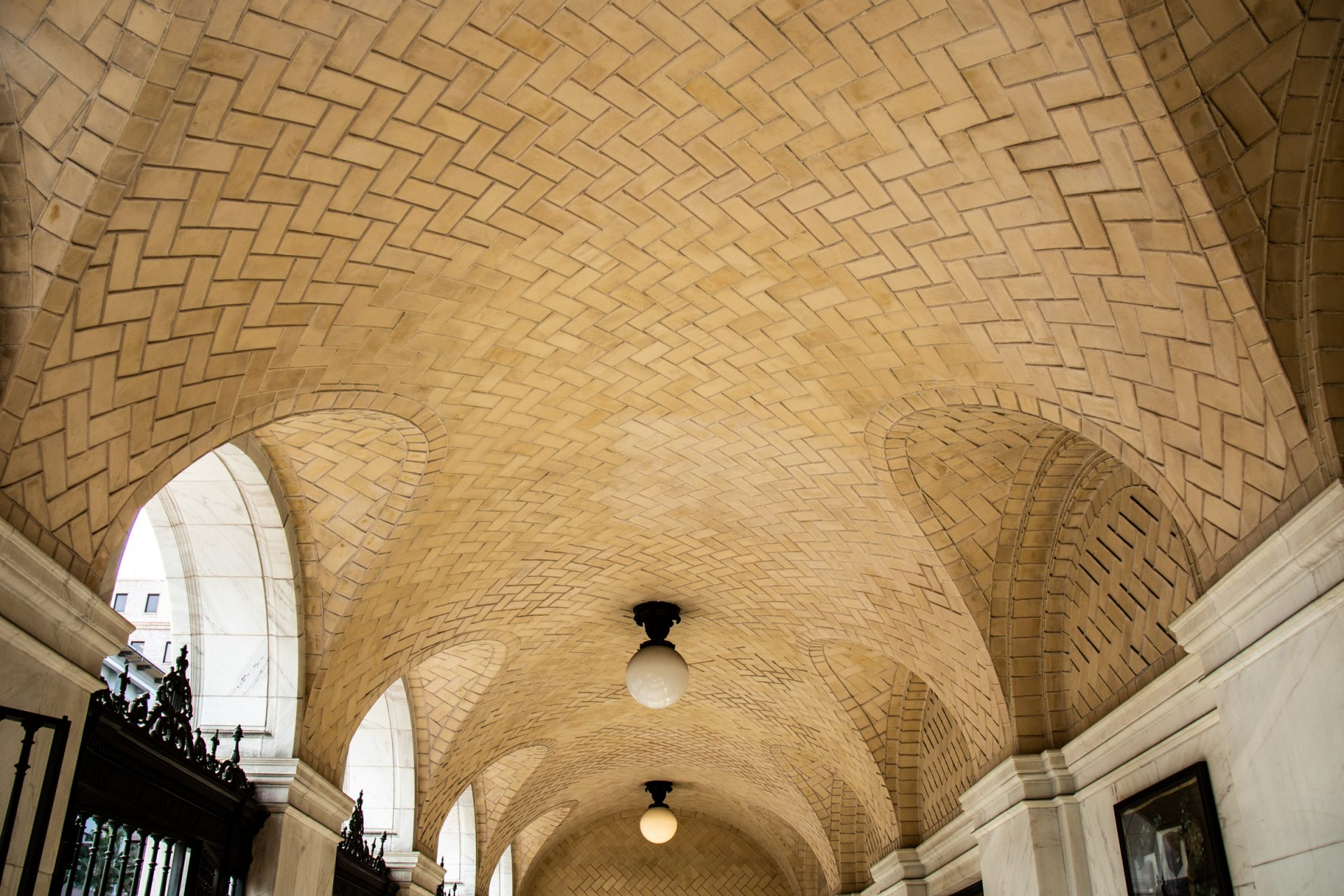 Patterned Ceiling Above Arched Passageway