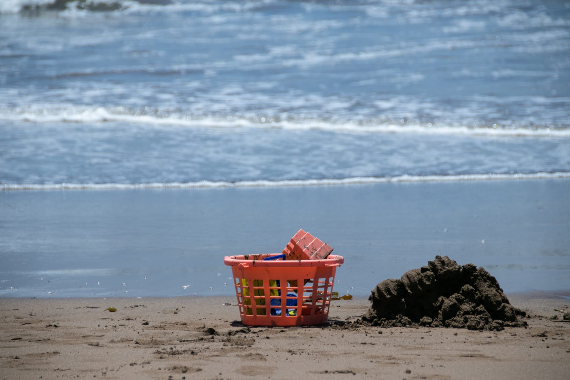 Sand Toys In Plastic Basket On Beach