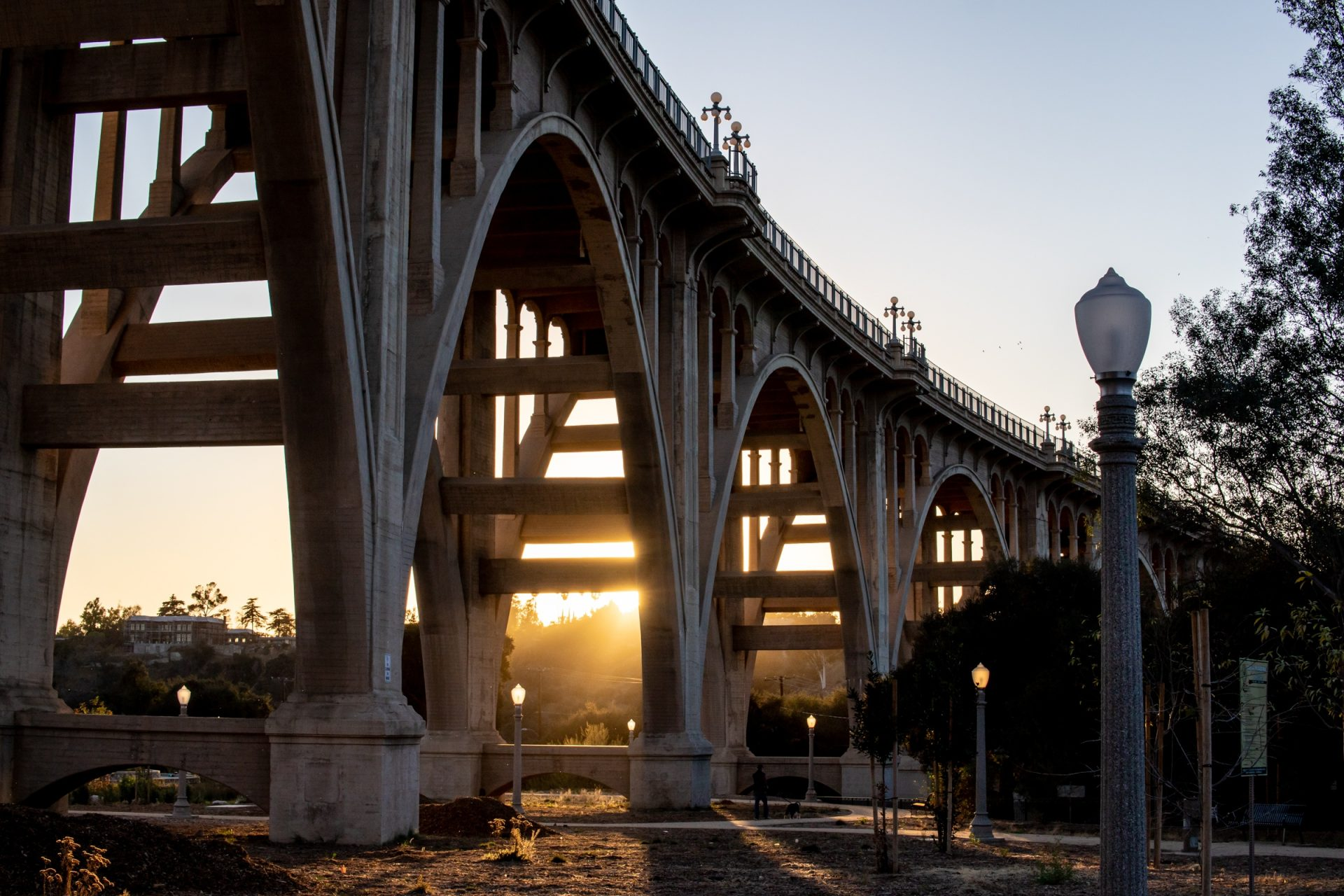 Sun Setting Beyond Viaduct Bridge