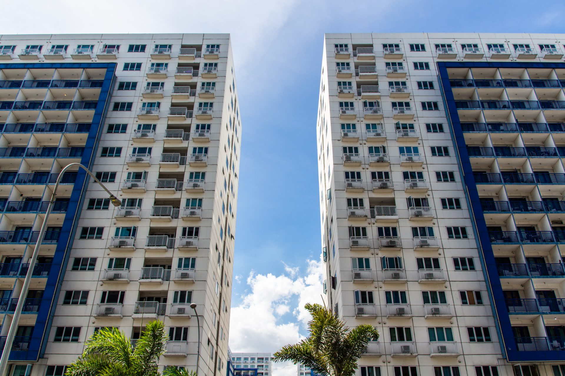 Two Identical Apartment Buildings In Manila