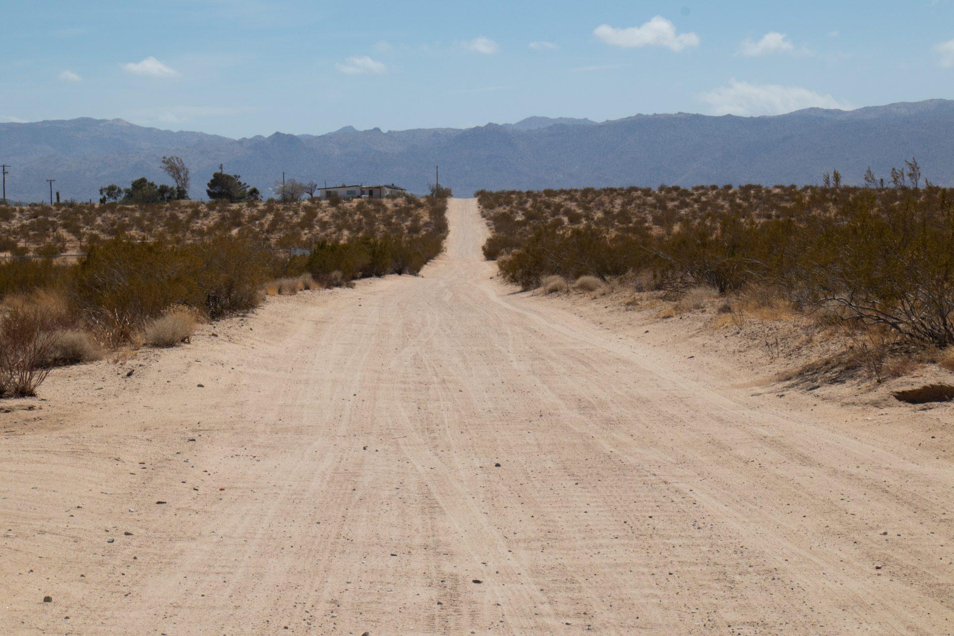 Hills Beyond Empty Dirt Road