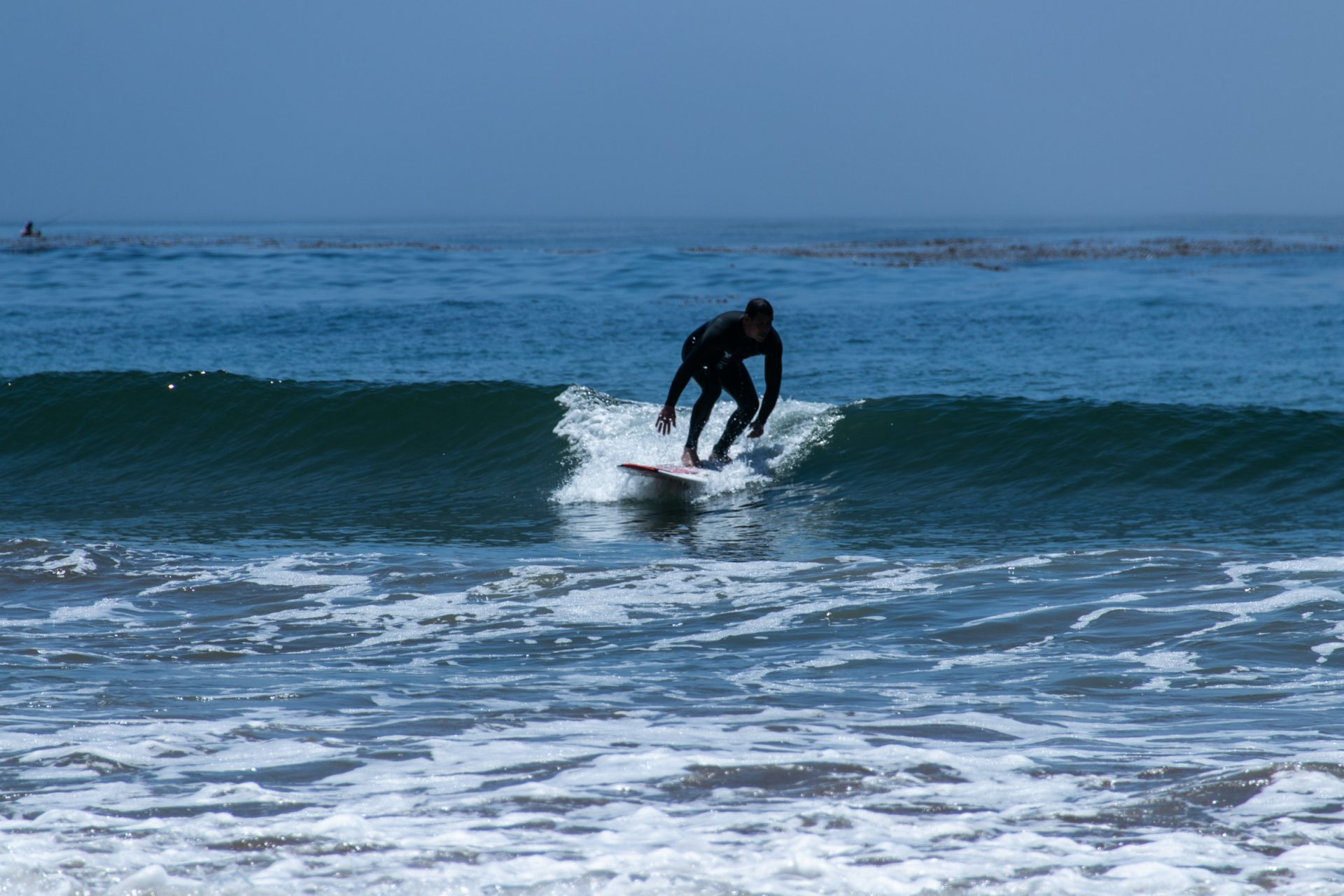 Man In Black Wetsuit Surfing Small Waves